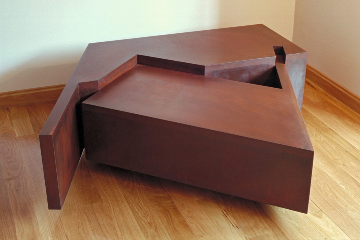 Table shaped sculpture made with corten steel and oxidized finish