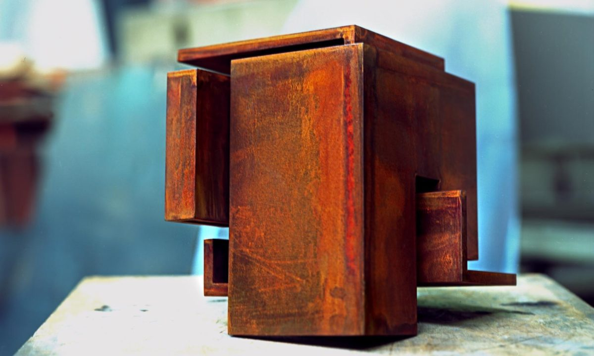 Corten steel sculpture with oxidized and waxed finish