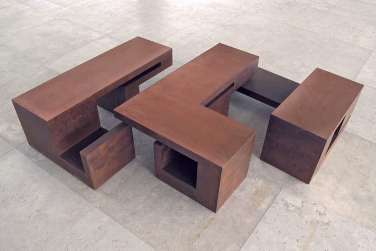 Box shaped sculpture by Arturo Berned, made with corten steel