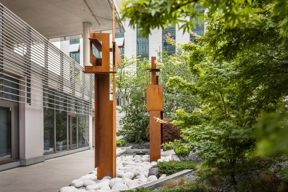 Corten steel sculpture with oxidized finish by Arturo Berned