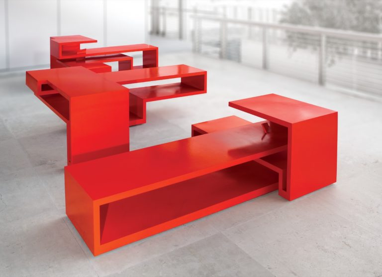 Table made by sculptor Arturo Berned with corten steel and red lacquered finish