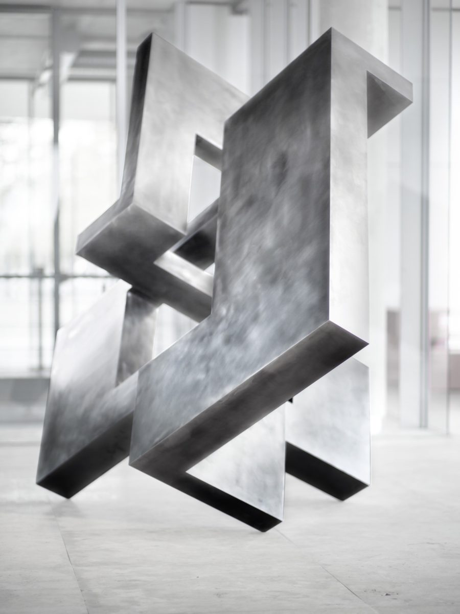 Stainless steel head with polished finish, by Arturo Berned