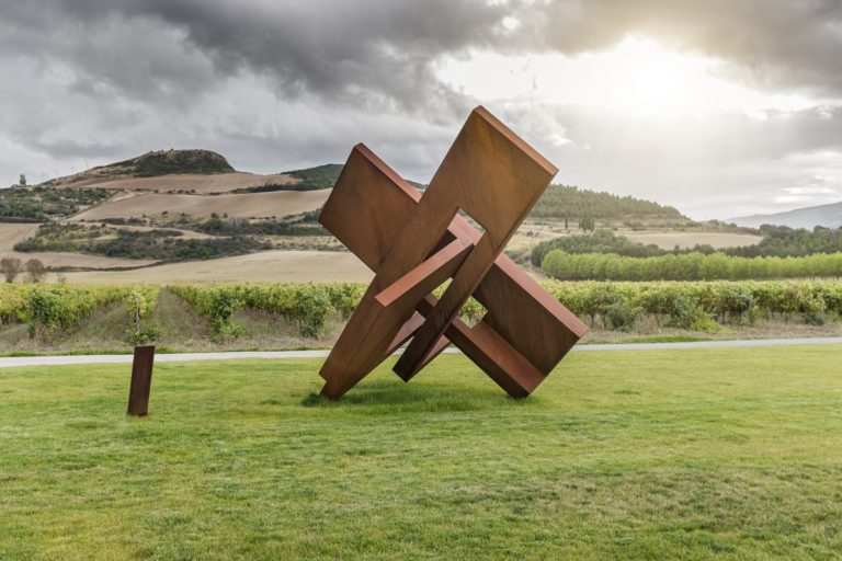 Geometric sculpture made with corten steel with oxidized finish