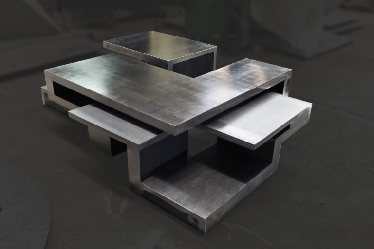 Non oxidized stainless steel table by Arturo Berned