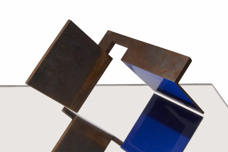 Corten steel sculpture by Arturo Berned with partially blue lacquered finish