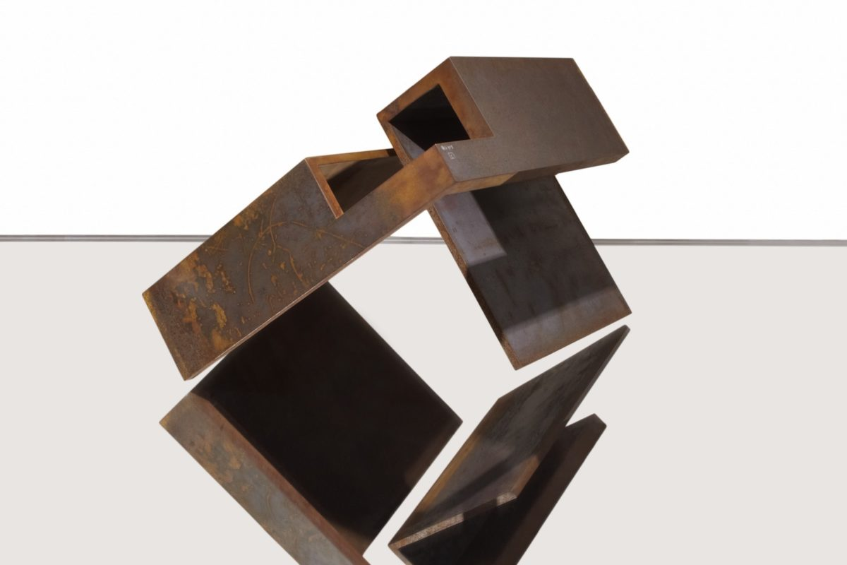 Geometric sculpture made with corten steel by Arturo Berned