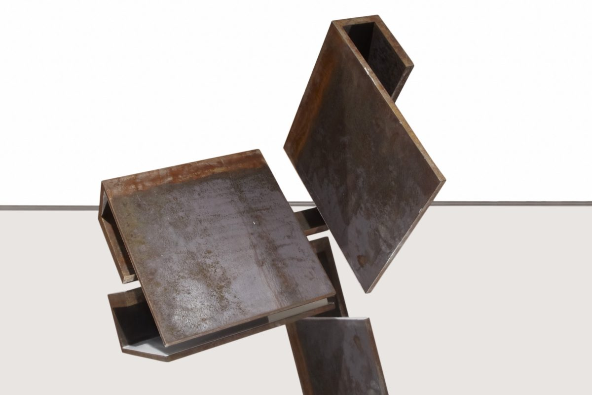 Geometric sculpture made with oxidized corten steel