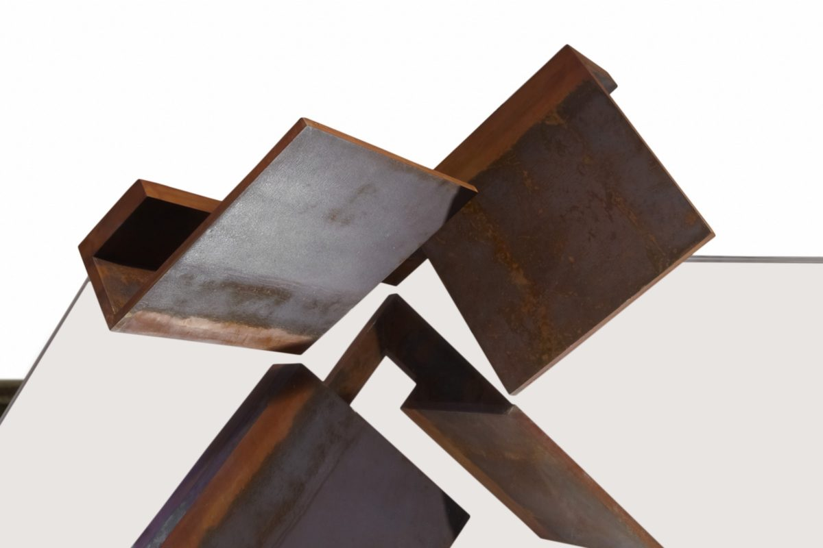Oxidized corten steel sculpture by Arturo Berned