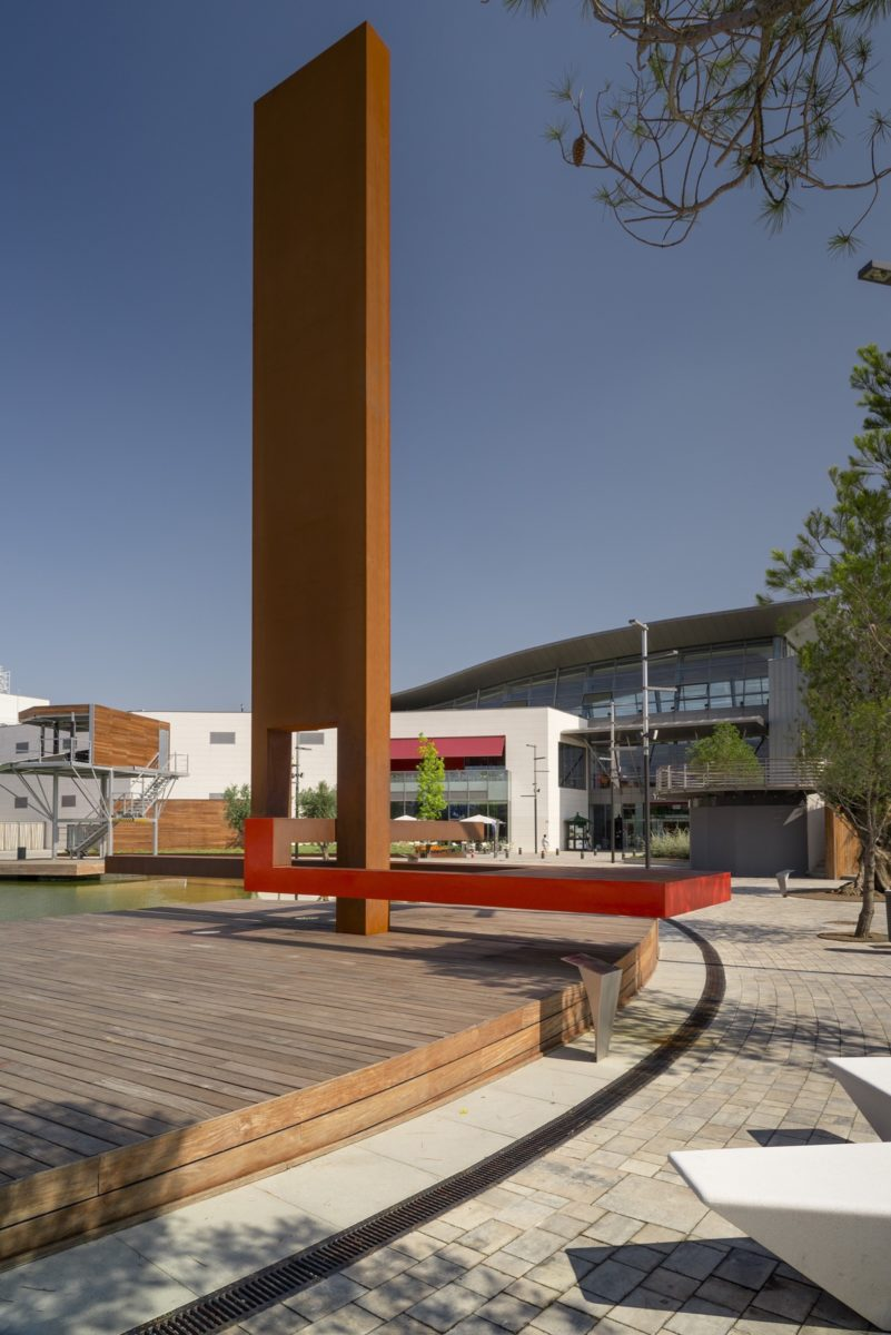 Sail shaped sculpture made with corten steel partially red lacquered