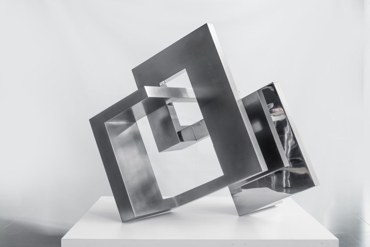 Piece of art from spanish sculptor Arturo Berned, made with stainless steel and chromed finish