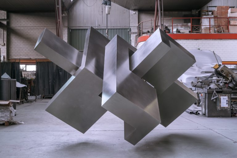 Stainless steel head by spanish sculptor Arturo Berned