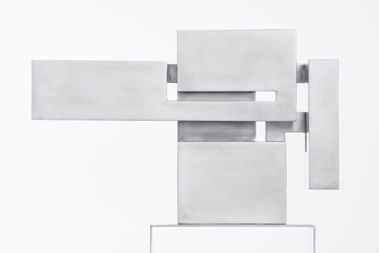 Polished stainless steel sculpture inspired by Mies van der Rohe architecture