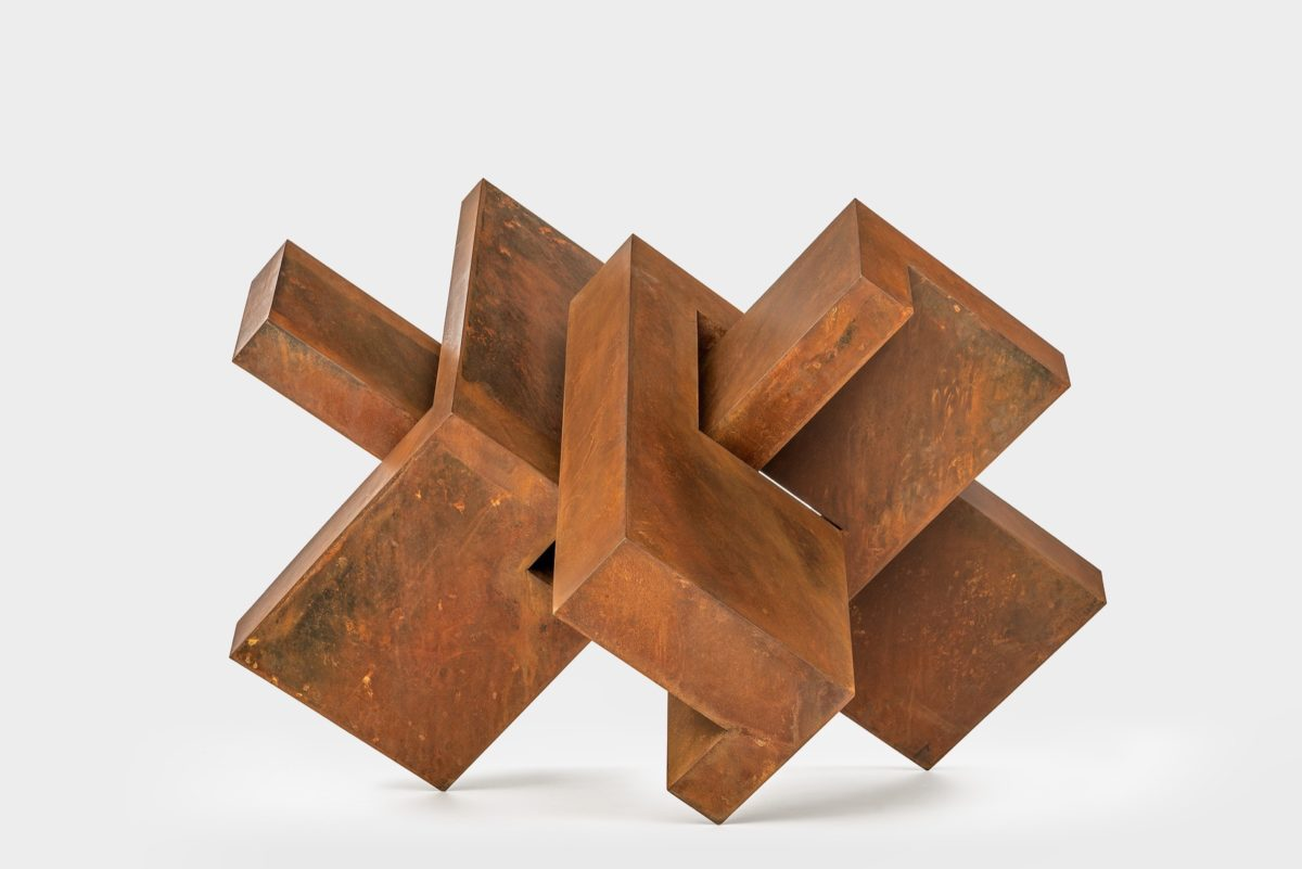 Geometric sculpture made with corten steel and lacquered and oxidized finish