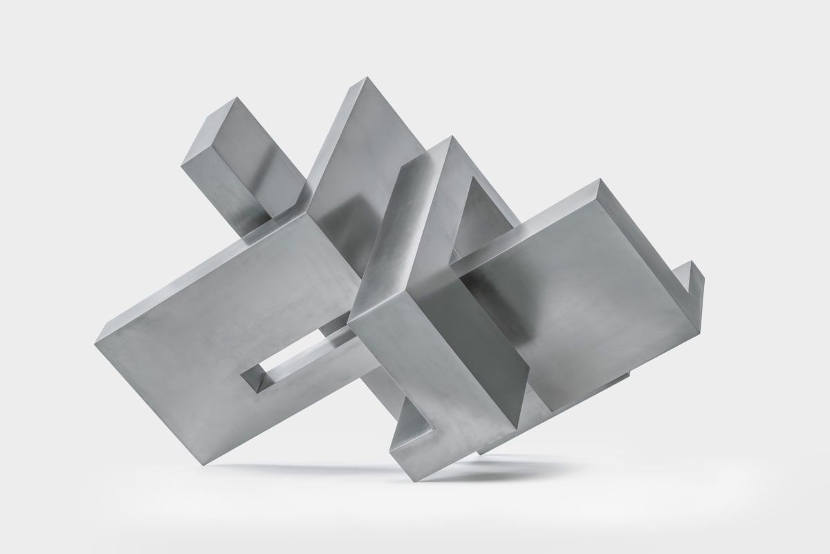 Geometric sculpture from Arturo Berned made with stainless steel