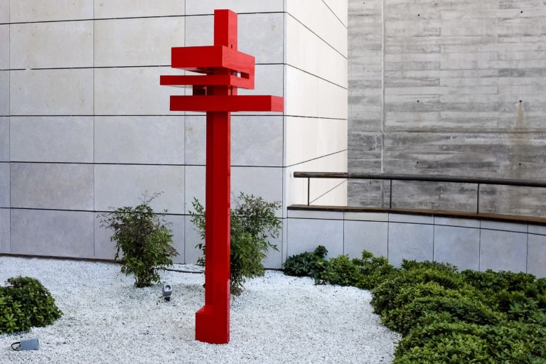 Constructivist sculpture made with corten steel with red lacquered finish
