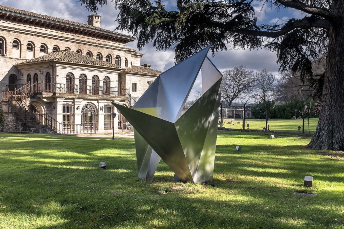 Stainless steel origami sculpture with polished finish
