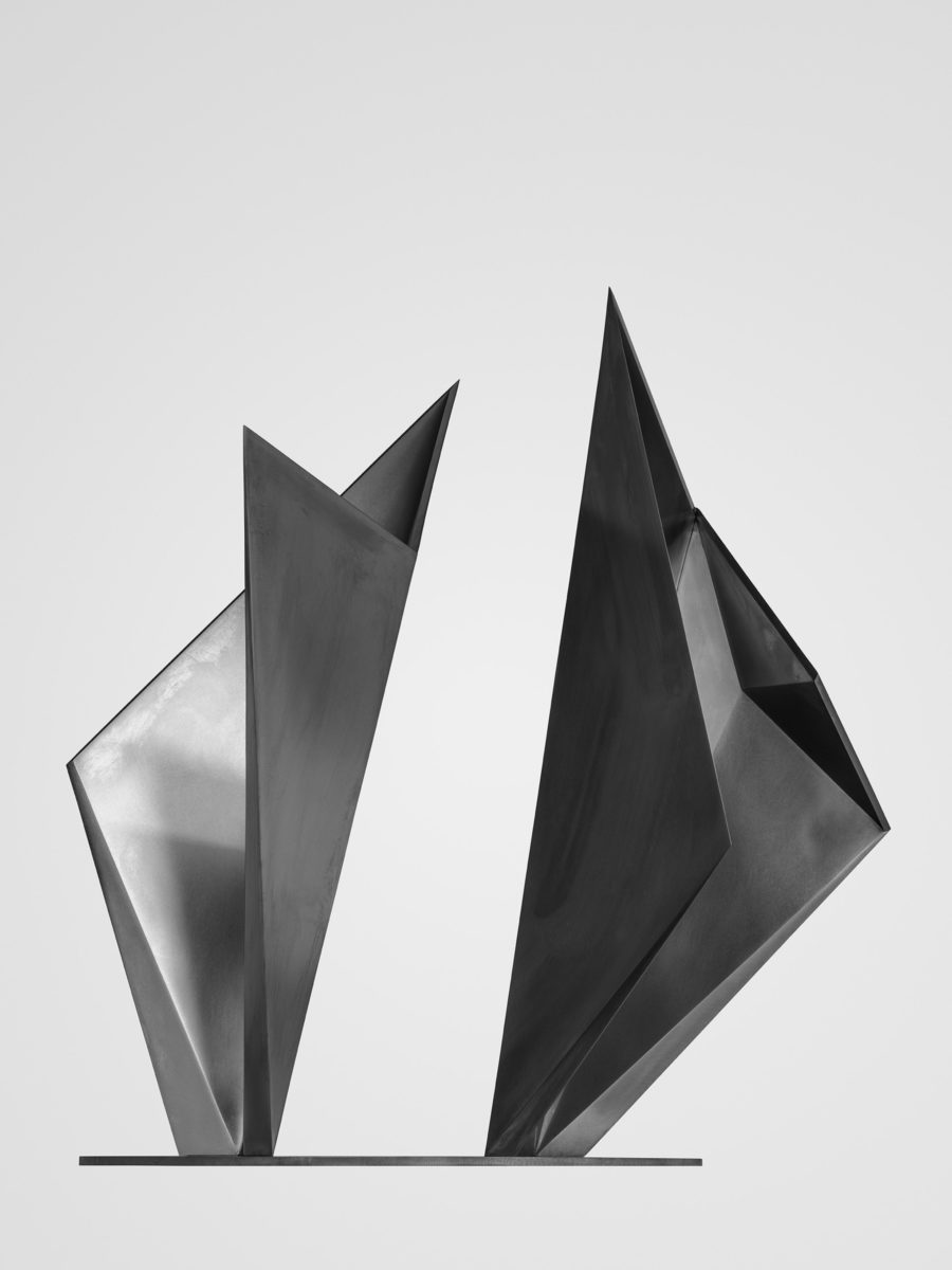 Stainless steel sculpture created as an origami game