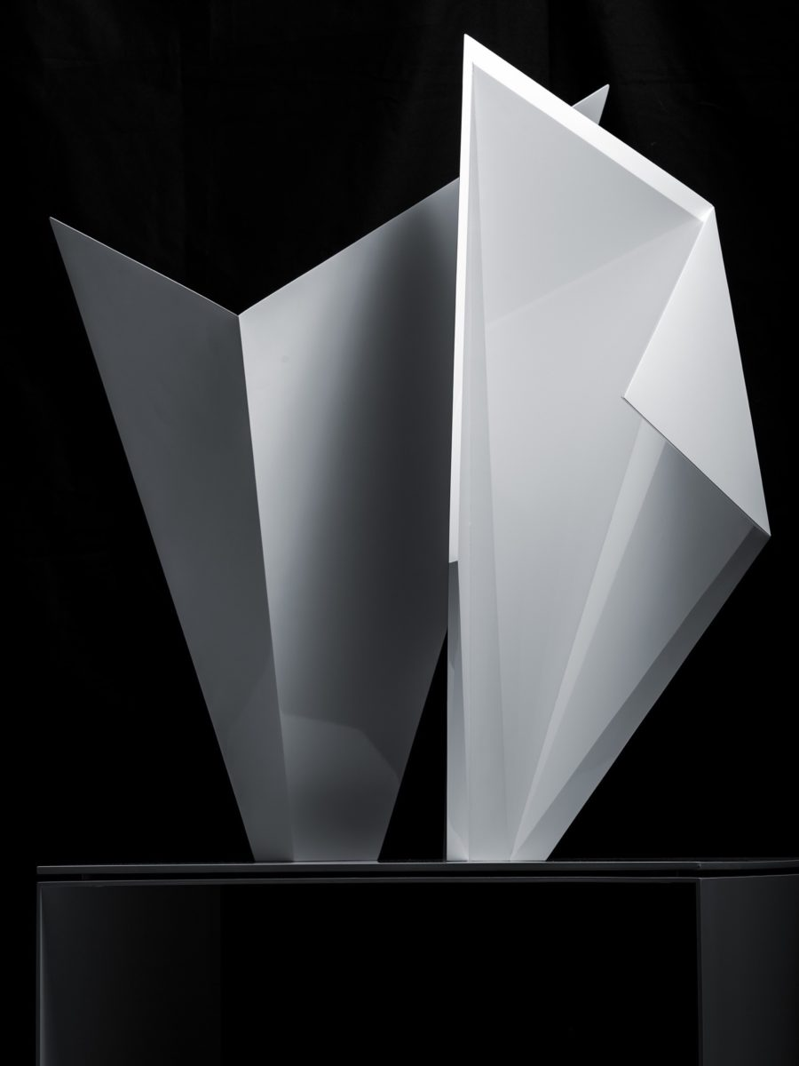 Stainless steel origami sculpture with white lacquered finish