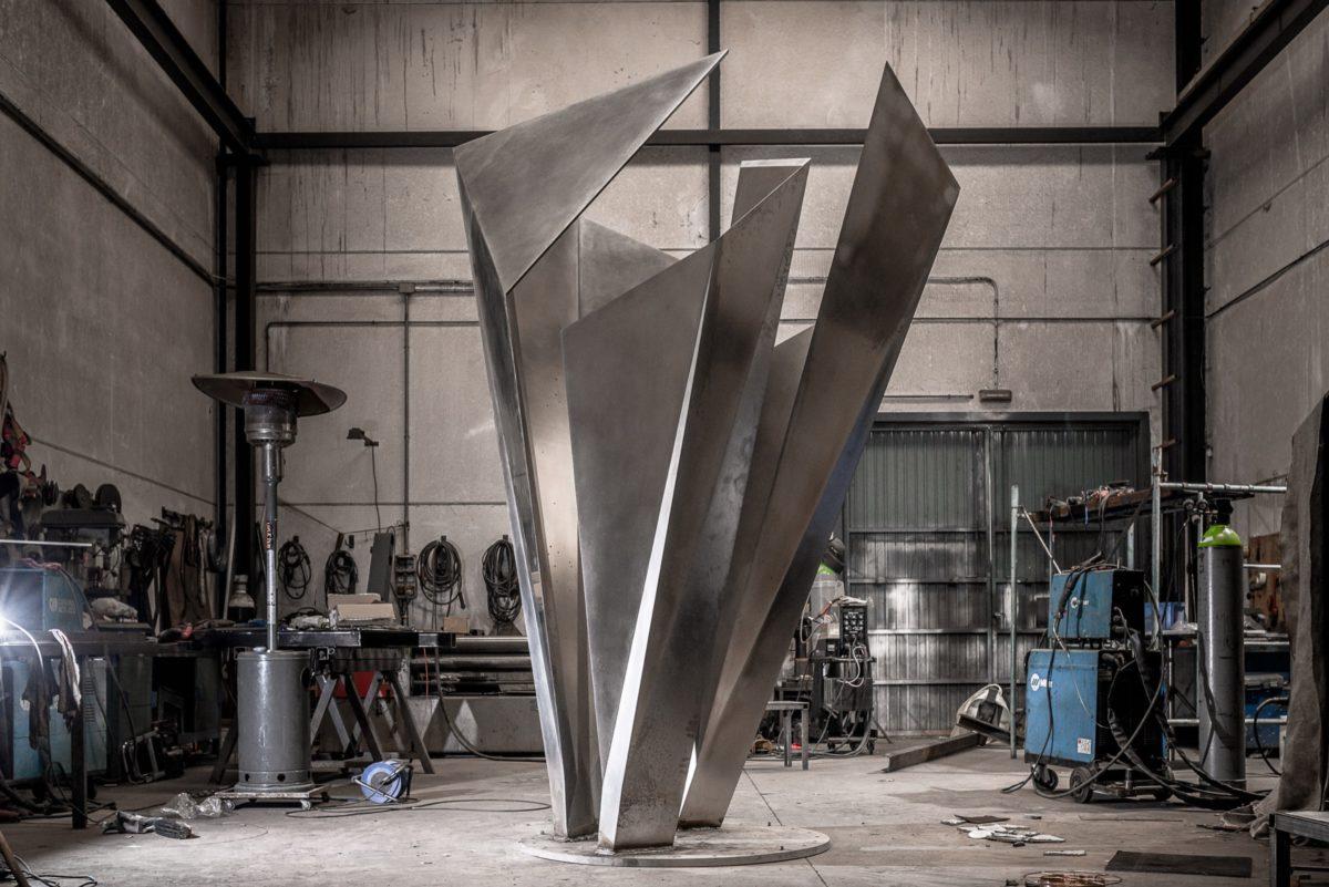 Origami de acero inoxidable pulido