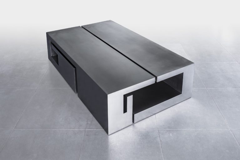 Stainless steel sculpture shaped like a box