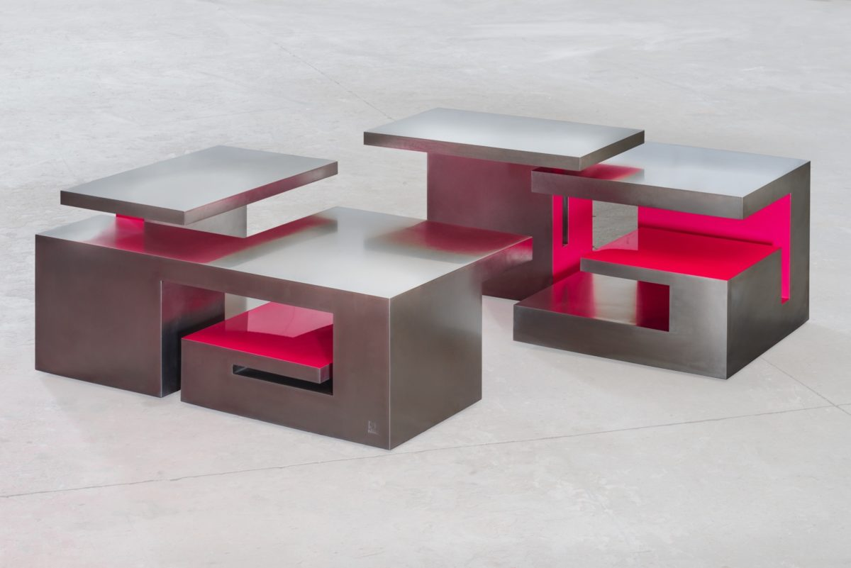 Table shaped sculpture, made from stainless steel and partially pink lacquered
